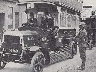 Photo from 1926 General Strike: police and soldiers guard a bus,