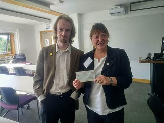Photo: Chair of the Society of the Study of Labour History, Joan Allen, handing over the cheque associated with the prize.