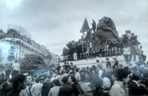 Photographer Elie Kagan atop the Lion statue at Place Denfert-Rochereau