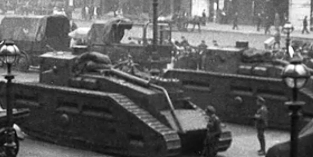 Image of a first world war tank on city streets.