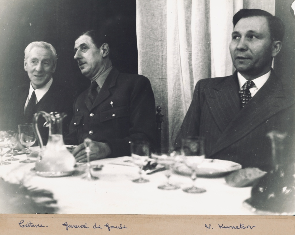Black and white photo of the three men named in the caption at a dining table.