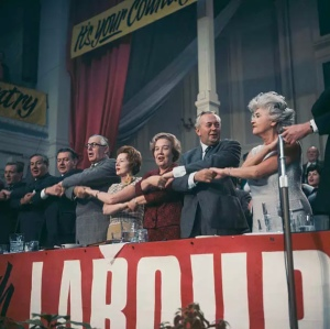 Harold Wilson joining hands with other leading figures from the Labour Party at a 1960s party conference.